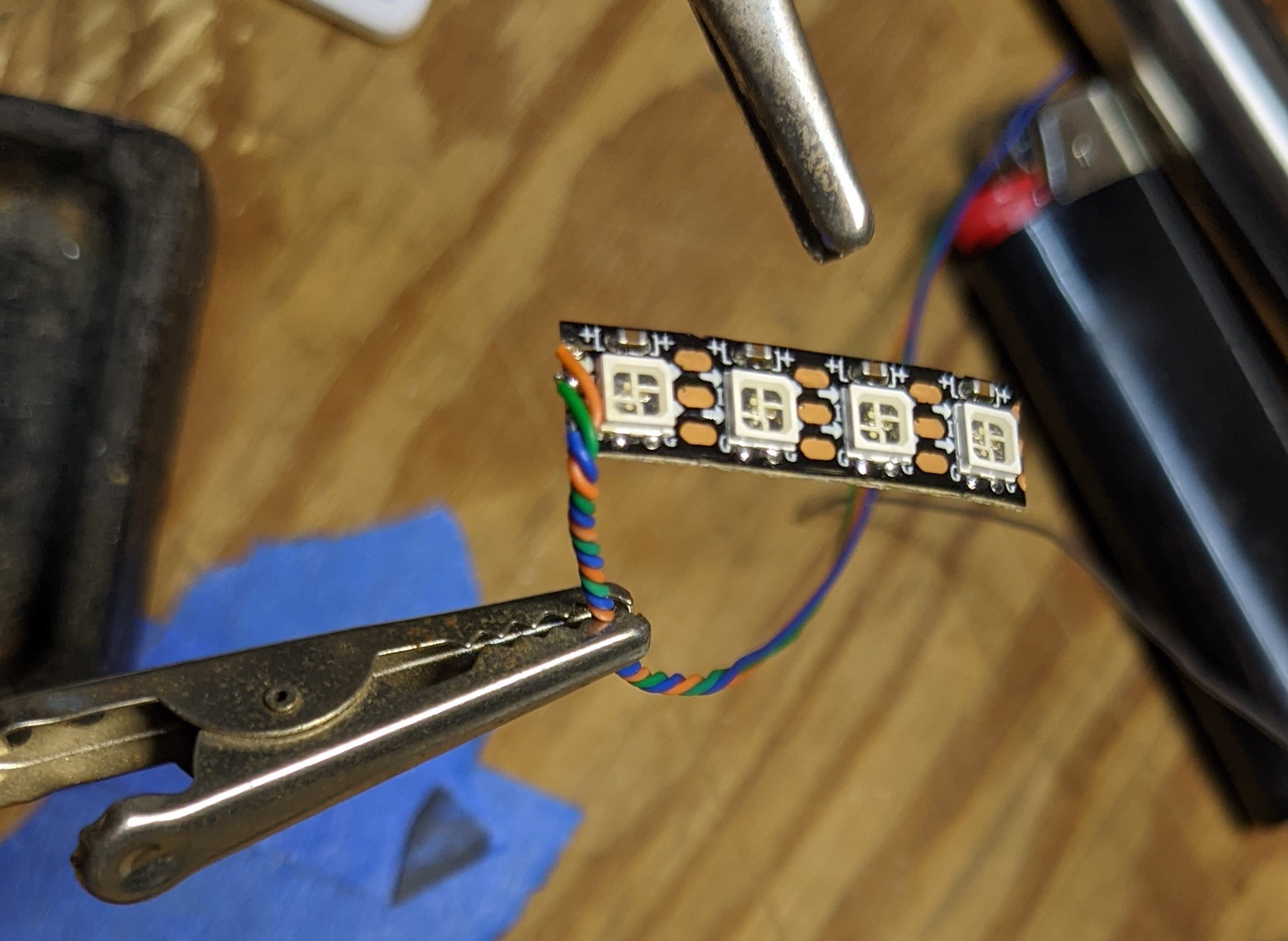 picture showing three wires from LED tape carefully braised together for a more compact and stronger cable