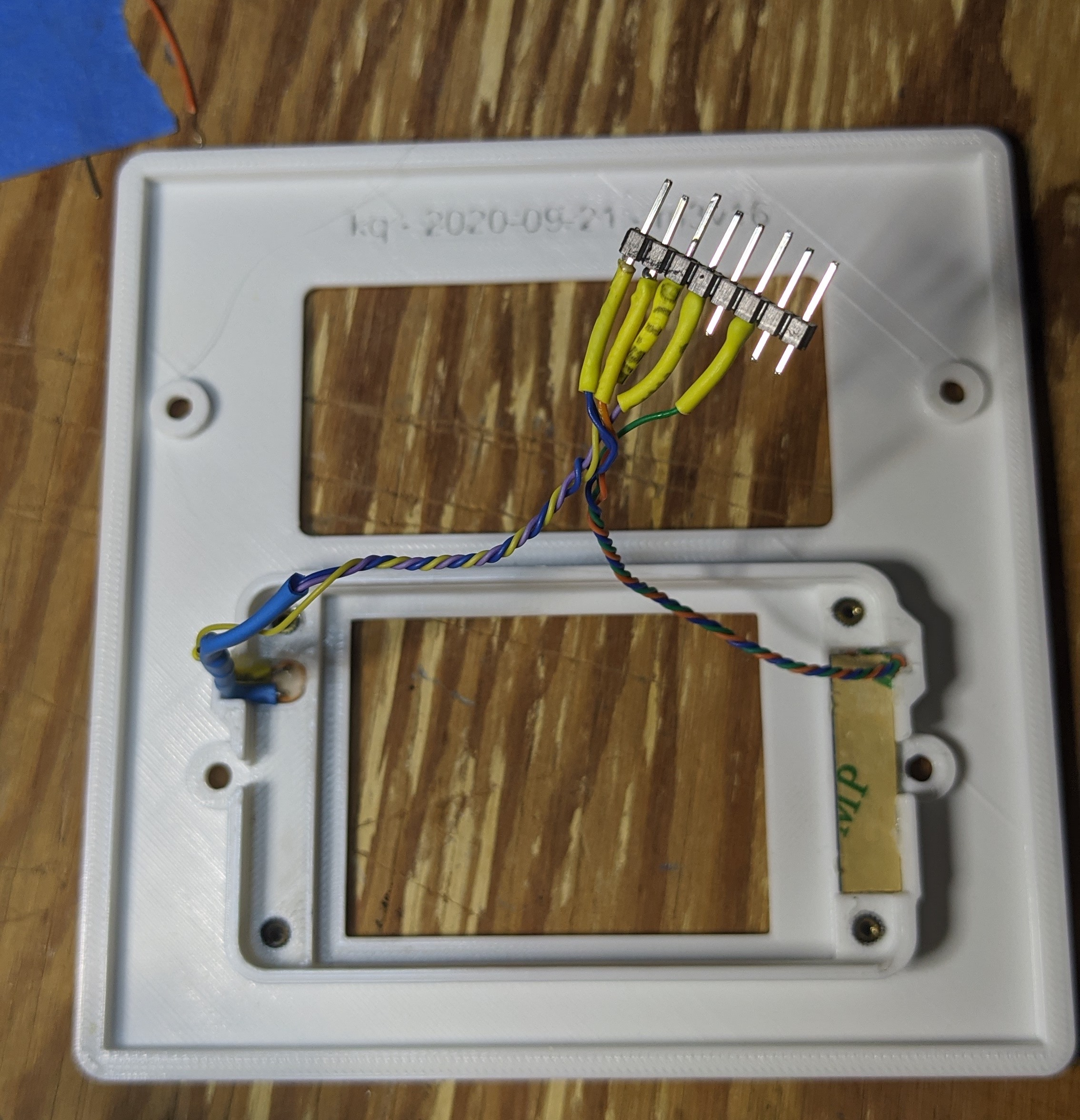picture showing each component in the decor plate and the finished wiring harness.
