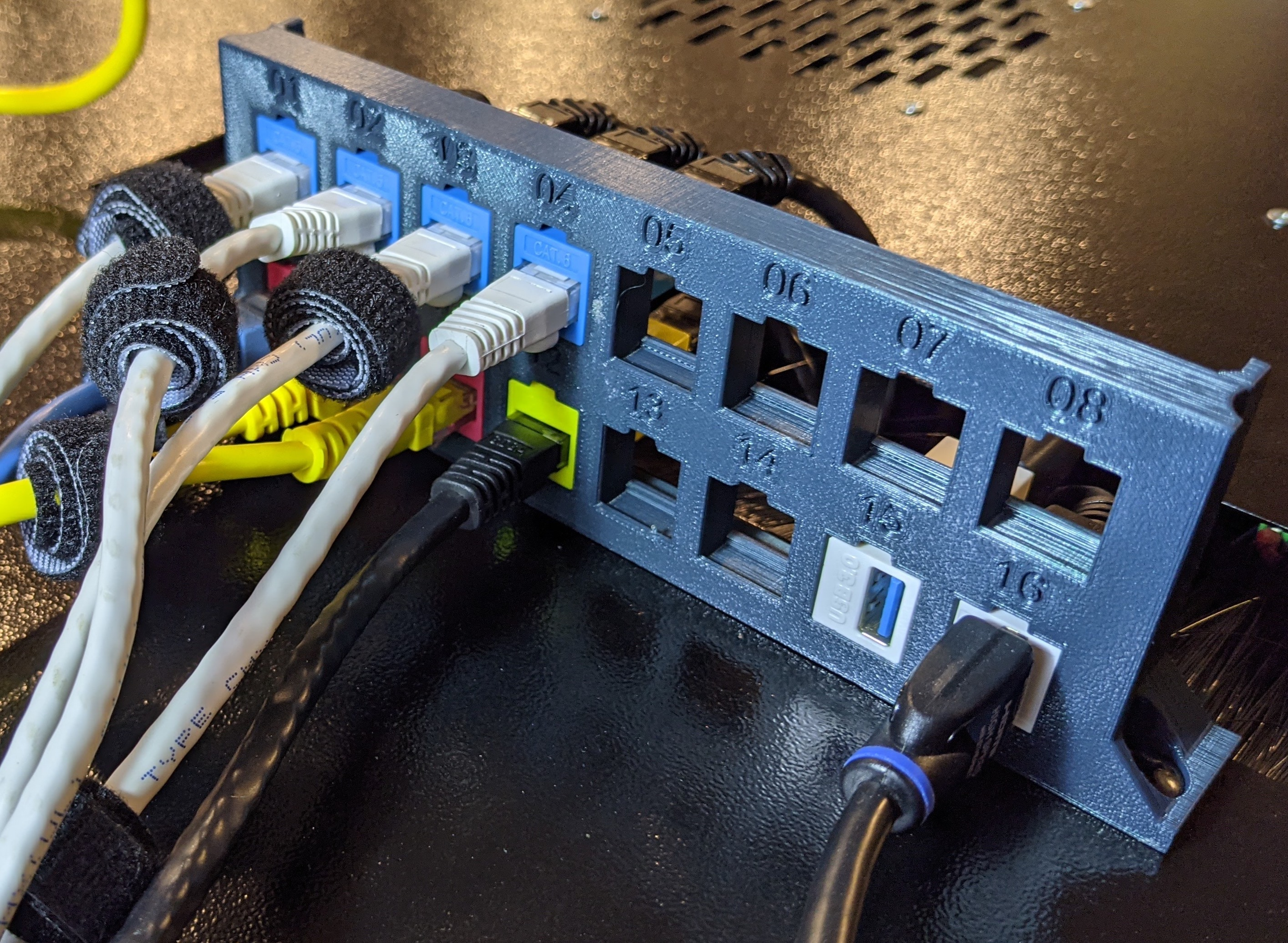 Picture showing the new 2x8 keystone bracket installed on rack from the front.